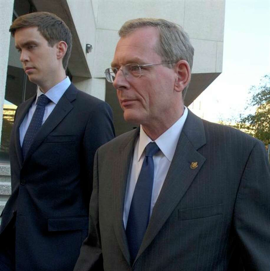 David  Rainey, a former BP vice president during the Deepwater Horizon oil rig explosion, leaves Federal Court after being arraigned on obstruction of a federal investigation in New Orleans, Wednesday, Nov. 28, 2012.   (AP Photo/Matthew Hinton) Photo: Matthew Hinton, AP / FR170690 AP