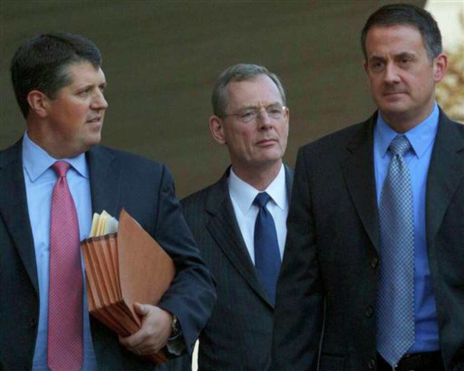 David  Rainey, a former BP vice president during the Deepwater Horizon oil rig explosion, center, leaves Federal Court after being arraigned on obstruction of a federal investigation in New Orleans, Wednesday, Nov. 28, 2012. Rainey and two BP rig supervisors pleaded not guilty Wednesday to criminal charges stemming from the deadly Deepwater Horizon rig explosion and the company's response to the massive 2010 spill in the Gulf of Mexico. (AP Photo/Matthew Hinton) Photo: Matthew Hinton, AP / FR170690 AP