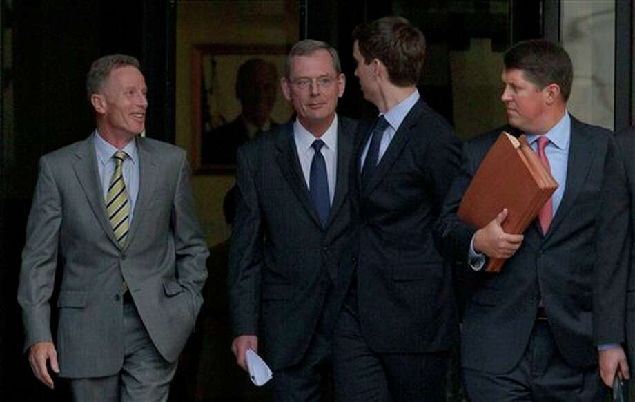 David Rainey, a former BP vice president during the Deepwater Horizon oil rig explosion, second from left, leaves Federal Court after being arraigned on obstruction of a federal investigation in New Orleans, Wednesday, Nov. 28, 2012. (AP Photo/Matthew Hinton) Photo: Matthew Hinton, AP / FR170690 AP