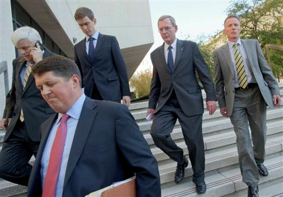 David Rainey, a former BP vice president during the Deepwater Horizon oil rig explosion, second from right, leaves Federal Court after being arraigned on obstruction of a federal investigation in New Orleans, Wednesday, Nov. 28, 2012. Rainey and two BP rig supervisors pleaded not guilty Wednesday to criminal charges stemming from the deadly Deepwater Horizon rig explosion and the company's response to the massive 2010 spill in the Gulf of Mexico. (AP Photo/Matthew Hinton) Photo: Matthew Hinton, AP / FR170690 AP