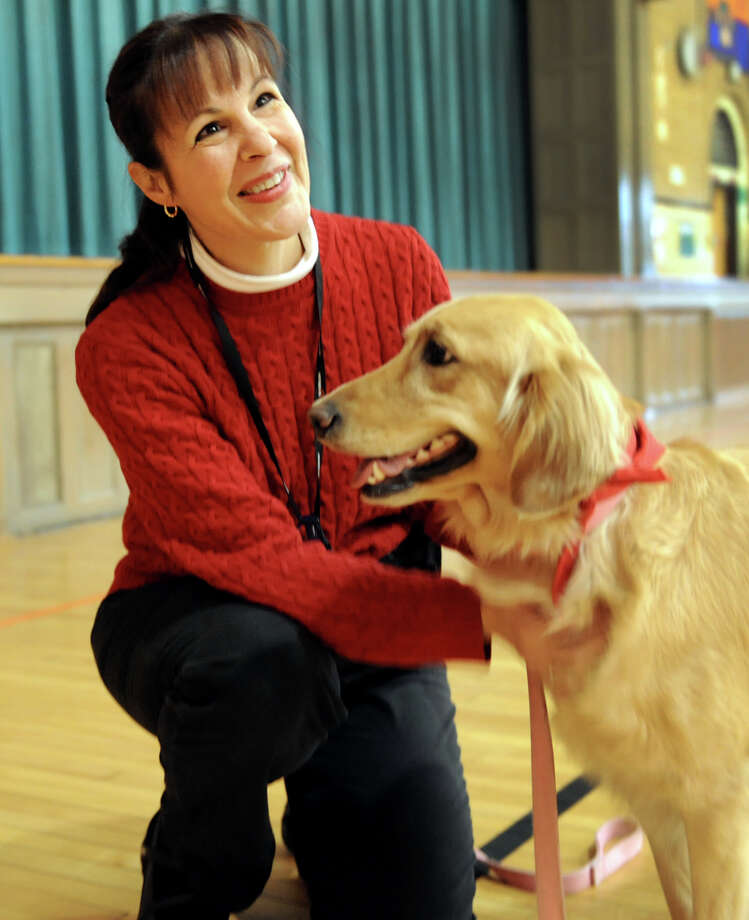 Fifth-grade teacher Jeannine Dowdle with her golden retriever Sadie, a 2-year-old therapy dog, after an assembly on Wednesday, Nov. 28, 2012, at Sacandaga Elementary School in Scotia, N.Y. (Cindy Schultz / Times Union) Photo: Cindy Schultz / 00020279A