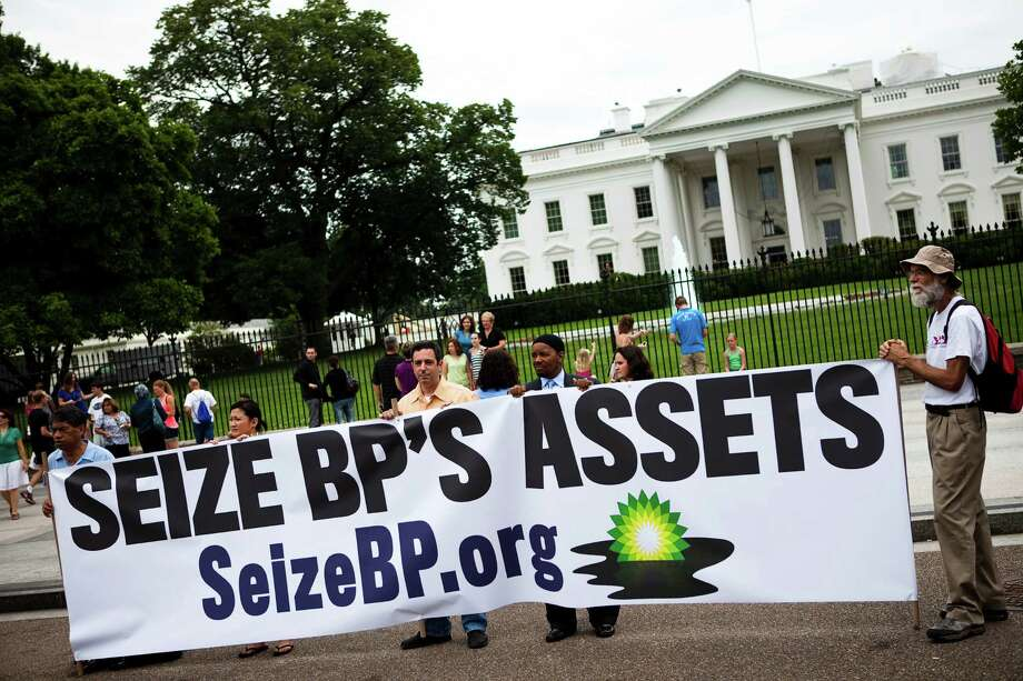"FILE- In this Tuesday, June 15, 2010, file photo, a group called ""Seize BP"" holds up an anti-BP sign in front of the White House, in Washington. The Obama administration put a temporary stop to new federal contracts with British oil company BP on Wednesday, Nov. 28, 2012, citing the company's ""lack of business integrity"" and criminal proceedings stemming from the Deepwater Horizon disaster in 2010. (AP Photo/Drew Angerer, File) Photo: Drew Angerer"