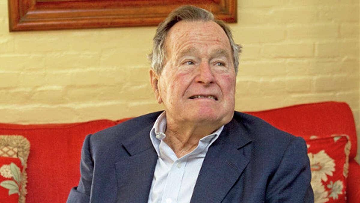 Former President George H.W. Bush waits for former Soviet leader Mikhail Gorbachev before having lunch together Thursday, Nov. 1, 2012, in Houston.