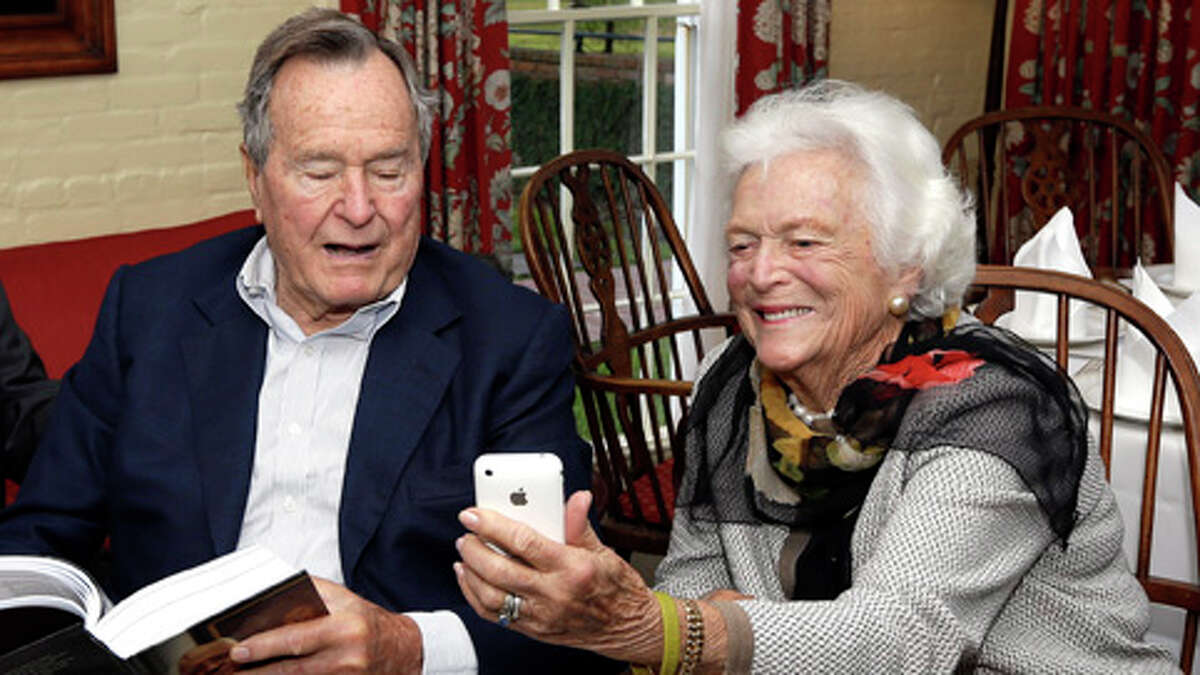 Former President George H.W. Bush and his wife, Barbara, check out Gorbachev family photos recently when former Soviet Union President Mikhail Gorbachevis was in Houston to speak at the Brilliant Lecture Series.