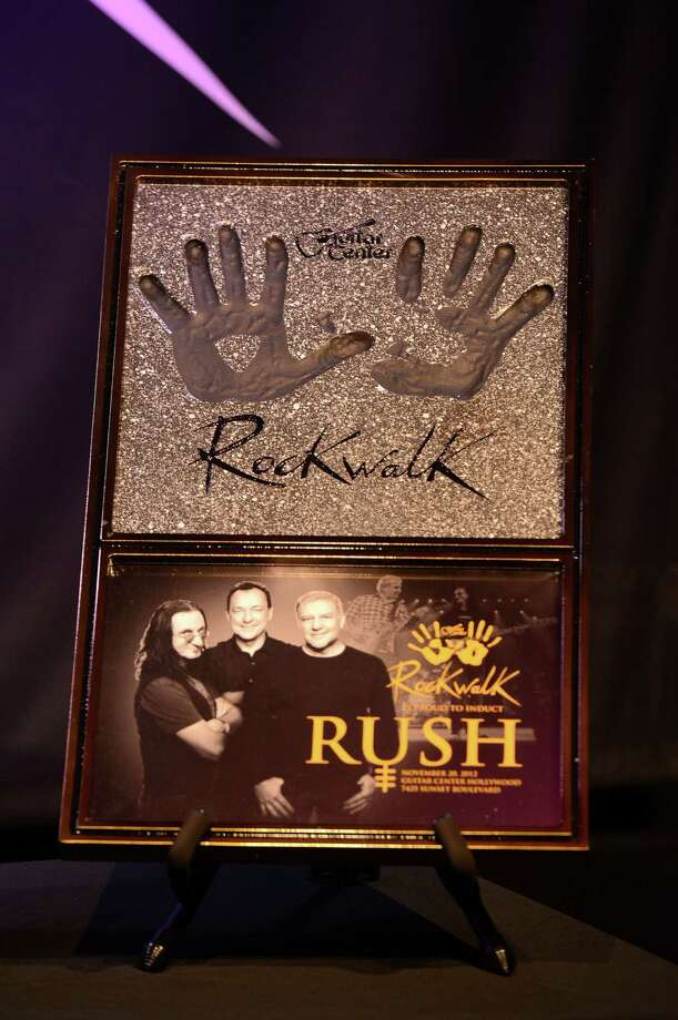 Rush Honored On Guitar Center's RockWalk at Guitar Center on November 20, 2012 in Hollywood, California. Photo: Frazer Harrison, Getty Images / 2012 Getty Images