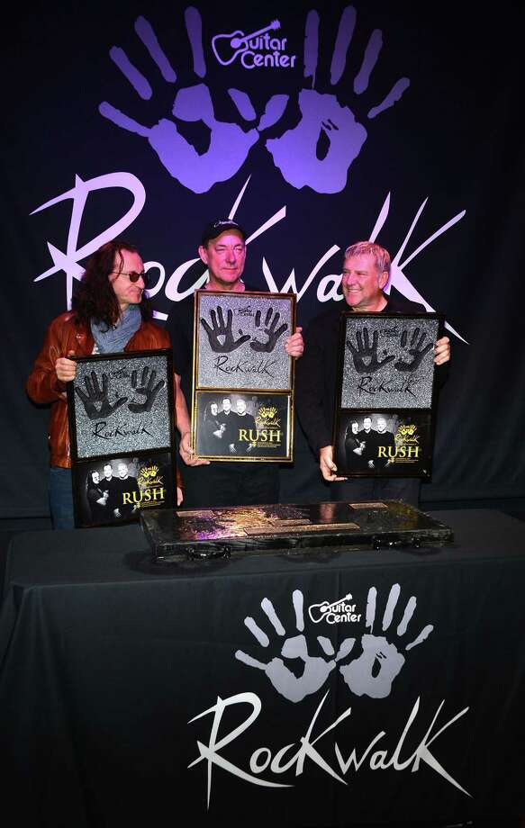 HOLLYWOOD, CA - NOVEMBER 20:  Rush (L-R ) Geddy Lee, Neil Peart, Alex Lifeson, Honored On Guitar Center's RockWalk at Guitar Center on November 20, 2012 in Hollywood, California. Photo: Frazer Harrison, Getty Images / 2012 Getty Images