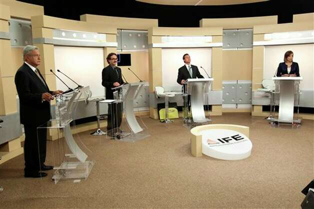 In this image provided by Mexico's Federal Electoral Institute, IFE, the presidential candidates participate in Mexico's second and last presidential debate in Guadalajara, Mexico, Sunday June 10, 2012. From left are Andres Manuel Lopez Obrador, presidential candidate for the Democratic Revolution Party (PRD), Gabriel Quadri, Presidential candidate for the New Alliance party (PANAL), Enrique Pena Nieto, presidential candidate for the Revolutionary Institutional Party (PRI) and  Josefina Vazquez Mota, presidential candidate for the National Action Party. (AP Photo/Federal Electoral Institute) Photo: AP / Federal Electoral Institute