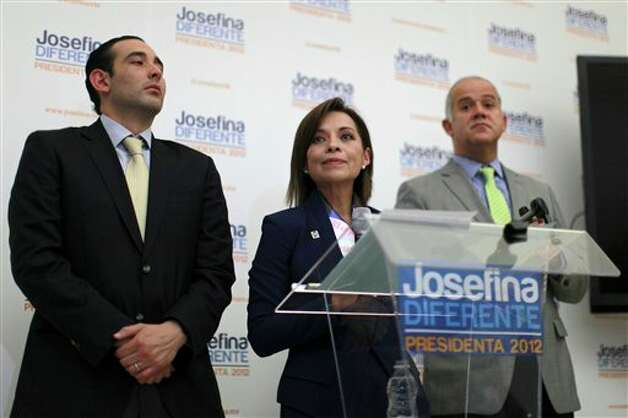Presidential candidate Josefina Vazquez Mota of the National Action Party (PAN), center, pauses during a news conference at her campaign headquarters in Mexico City, Wednesday, June 6, 2012. At left is her campaign manager Roberto Gil Zuarth and at right is her new spokesman Juan Ignacio Zavala. Next July 1, Mexico will hold presidential elections. (AP Photo/Dario Lopez-Mills) Photo: Dario Lopez-Mills, AP / AP