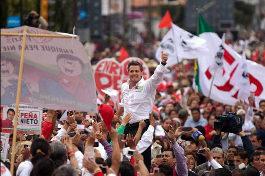 Enrique Pena Nieto, waving to supporters during Sunday's campaign rally in Altacomulco, Mexico, is running for president on the Institutional Revolutionary Party (PRI) ticket. (AP)