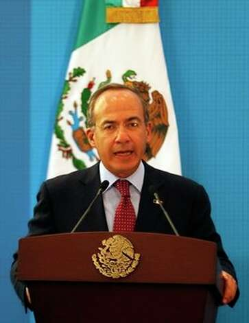 Mexico's President Felipe Calderon speaks during a news conference at the Los Pinos presidential residence in Mexico City, Monday, April 26, 2010. Calderon's term ends this year. Photo: Eduardo Verdugo, AP / AP