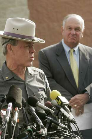 (Caption Information) Major Gerald Meyer, addresses journalist during a press conference, as Village of Lake George Mayor, Robert M. Blais, looks on  Tuesday, October 4, 2005 at the Warren County Sheriff's Department in Queensbury, New York to discuss the latest information on The Ethan Allen accident on Lake George. Photo: Elizabeth Conley, The Detroit News / The Detroit News