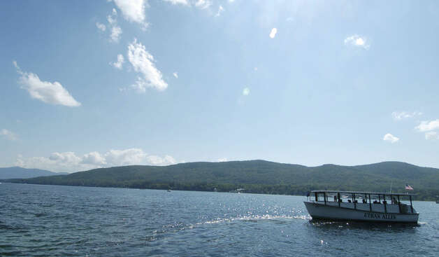 ** FILE ** The Ethan Allen tour boat is shown on Lake George in a file photo from July 20, 2005, in Lake George, N.Y.  The glass-enclosed boat carrying tourists on a senior citizens' cruise overturned Sunday, Oct. 2, 2005, killing at least 20 people and sending more than two dozen cold and wet passengers to a hospital.(AP Photo/The Albany Times Union, Skip Dickstein, File) ** MANDATORY CREDIT ** Photo: SKIP DICKSTEIN, AP / ALBANY TIMES UNION