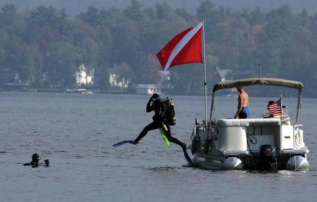 A second diver with the Scuba Unit of the Warren County Sheriff's department jumps into Lake George on Tuesday, Oct. 4, 2005, at Lake George, N.Y., at the site where the tour boat Ethan Allen sank on Sunday killing 20 people. The sheriff said that the divers were looking for articles that went down with the boat. Photo: JIM MCKNIGHT, AP / AP