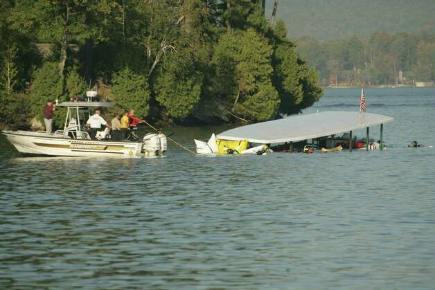 The Ethan Allen tour boat is towed after being brought to the surface of Lake George on Monday, Oct. 3, 2005, at Lake George, N.Y. The boat carrying tourists on a senior citizens' cruise overturned Sunday killing 20 people and sending more than two dozen others to a hospital. Photo: MARY ALTAFFER, AP / AP