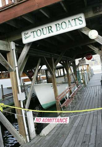 (Caption Information) Photos of Shoreline Cruises' closed boats in Lake George Village on Tuesday, October 4, 2005. The company suspended cruises after The Ethan Allen flipped over Sunday, October 2, 2005.  (The Detroit News/Elizabeth Conley)(Caption Information) National Transportation Safety Board acting chairman Mark Rosenker responds to reporters questions during an early evening briefing on Tuesday, October 4, 2005 at the Warren County Sheriff's office. Photo: Elizabeth Conley, The Detroit News / The Detroit News