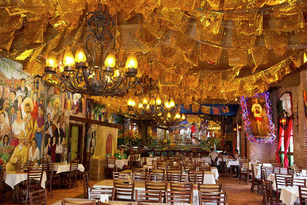FOR TASTE - A dining area is pictured at Mi Tierra on Monday, Nov. 26, 2012. MICHAEL MILLER / FOR THE EXPRESS-NEWS Photo: Michael Miller, San Antonio Express-News / © San Antonio Express-News