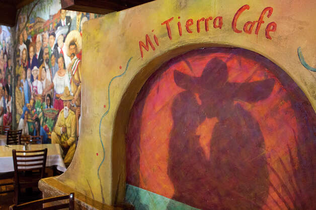 FOR TASTE - Art on the walls is pictured at Mi Tierra on Monday, Nov. 26, 2012. MICHAEL MILLER / FOR THE EXPRESS-NEWS Photo: Michael Miller, San Antonio Express-News / © San Antonio Express-News