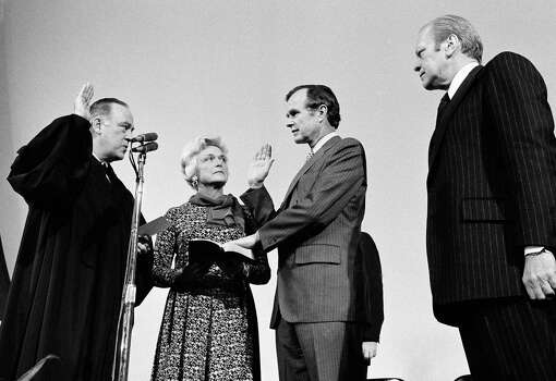 George Bush is sworn in as new director of the Central Intelligence Agency by Supreme Court Associate Justice Potter Stewart, left, as Mrs Barbara Bush and President Gerald Ford, at right, look on at CIA headquarters in Langley, Va., January 30, 1976.     Bush succeeds William Colby who retired. (AP Photo) Photo: Anonymous, ASSOCIATED PRESS / AP