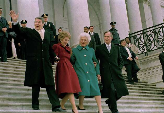 Former President Ronald Reagan, left, his wife Nancy Reagan, new first lady Barbara Bush and her husband President George Bush, right, walk down the Capitol steps after the inaugural ceremony in Washington, D.C., Friday, Jan. 20, 1989.  President Bush was sworn in as the nation's 41st president.  The Reagans are heading to an awaiting helicopter to take them to Andrews Air Force Base, Md., and onto California.  (AP Photo/J. Scott Applewhite) Photo: J. SCOTT APPLEWHITE, ASSOCIATED PRESS / AP
