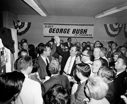 Republican George Bush, left, has his hand raised in victory by newly elected Democrat Bob Eckhardt of the 8th Congressional District of Harris County. Bush, winner of the newly created 7th Congressional District of Harris County, won the election over Democrat Frank Briscoe, Eckhardt defeated W.D. Spayne of the Constitutional Party. The victory celebration took place in Bush's campaign headquarters late Tuesday night, Nov. 9, 1966. Photo: Ed  Kolenovsky, AP / AP