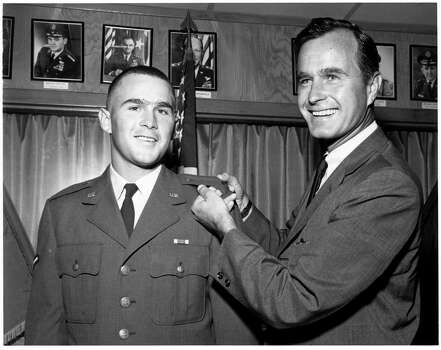 NO SALES, NO AP, DO NOT RELEASE  HOUCHRON CAPTION (04/11/1999): A young George W. Bush is welcomed into a Houston unit of the Texas Air National Guard in 1968 by his father, then-Congressman George Bush, a former Navy pilot.  HOUCHRON CAPTION (07/04/1999): U.S. Rep. George Bush, a former Navy pilot, welcomes his son, George W., into a Houston unit of the Texas Air National Guard in 1968.  HOUCHRON CAPTION (12/14/2000): A young George W. Bush is welcomed into the Texas Air National Guard in 1968 by his father, who was then a congressman.   HOUCHRON CAPTION (02/22/2004-2-STAR):   The service records of John Kerry, (Not in picture) and George W. Bush,  have become a key issue in the race for the White House. The service of National Guardsman George W. Bush, with his father, George H.W. Bush, has Been the focus of recent questions about the president's character. Most of the attention centers on a period in 1972 when he transferred to a Guard unit in Alabama.  HOUCHRON CAPTION (02/22/2004): The service records of John Kerry (NOT PICTURED) and George W. Bush have become a key issue in the race for the White House. . . . Bush, a National Guardsman, is seen with his father, George H.W. Bush, in an undated photo. Photo: TEXAS AIR NATIONAL GUARD MUSEUM, TEXAS AIR NATIONAL GUARD / TEXAS AIR NATIONAL GUARD