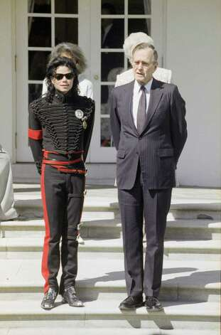 "President George H.W Bush welcomes singer Michael Jackson, who was named ""Entertainer of the Decade""  by the Friends of the Children's Museum in Washington to the White House Thursday, April 20, 1990.   Standing behind are daughter-in-law Margaret Bush and first lady Barbara Bush. (AP Photo/Ron Edmonds) Photo: Ron Edmonds, ASSOCIATED PRESS / AP"