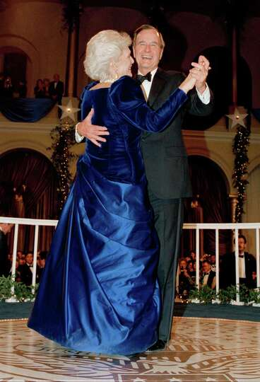 President  George H.W. Bush and wife, Barbara dance at the inaugural ball at the Pension Building in