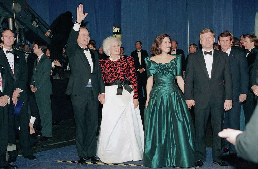 President elect-George H.W. Bush and his wife Barbara, pose with Vice President-elect Dan Quayle and