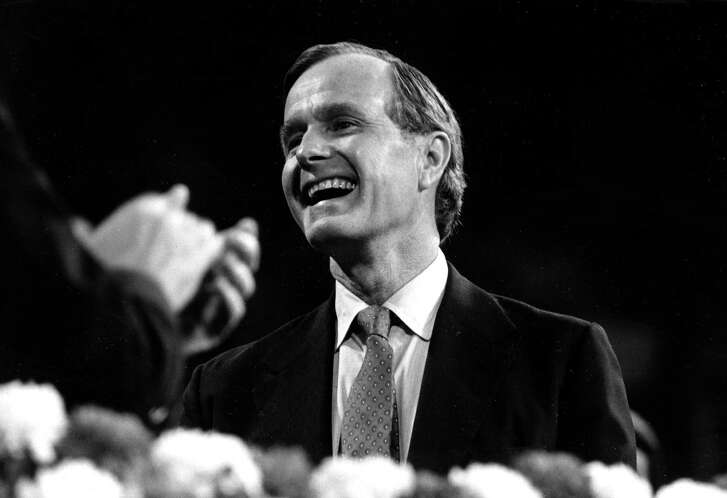 Republican vice presidential candidate George Bush reacts to applause from the assembled Republican delegates at the Republican National Convention at Joe Louis Arena in Detroit, Mich., Thursday evening, July 17, 1980.  Bush was selected by Ronald Reagan as his running mate on Wednesday.  (AP Photo)