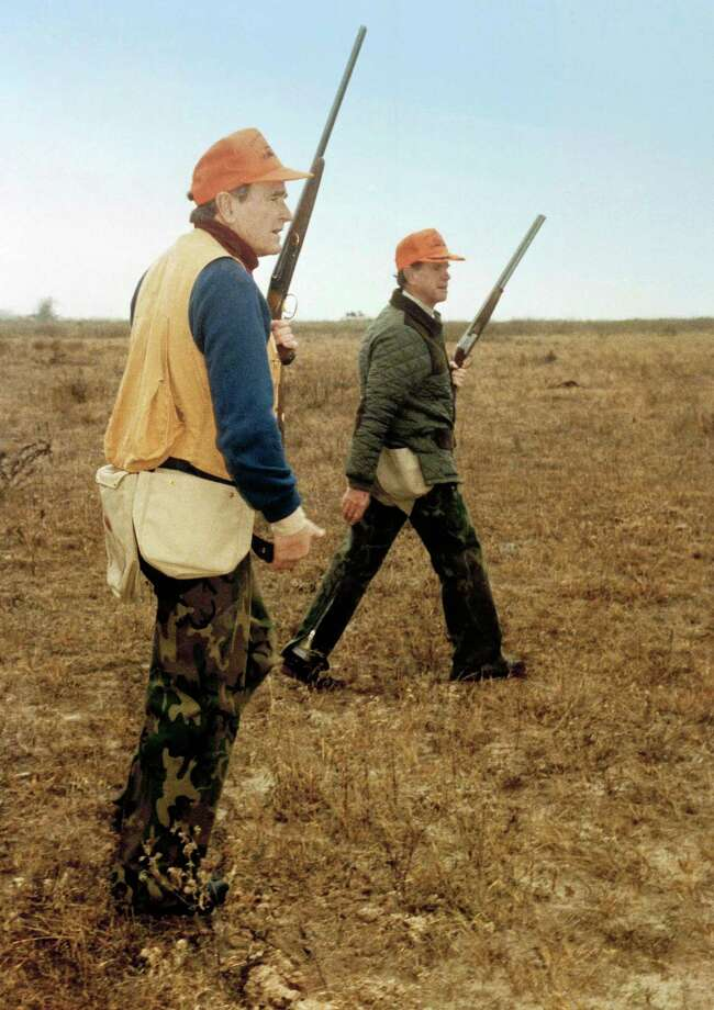 President George H.W. Bush, left, and Will Farish hunt quail December 28, 1989  on the Lazy F Ranch near Beeville, Texas.  Photo: David Valdez, AP / WHITE HOUSE