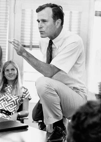 Rep. George H.W. Bush, R-Texas., who is seeking a seat in U.S. Senate, talks with a group of young people at a rally in Houston, Texas., on Oct. 9, 1970.    Bush is opposed by Lloyd Bentsen, wealthy Houston businessman, who defeated Sen. Ralph Yarborough in the State Democratic Primary. (AP Photo) Photo: Anonymous, ASSOCIATED PRESS / AP