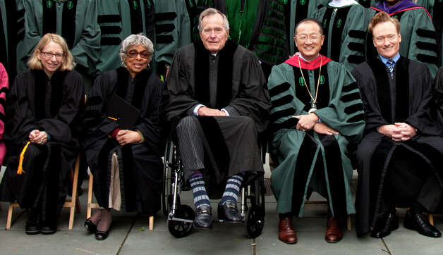 Former U.S. President George HW Bush( center) poses for a photograph with Dartmouth College President Jim Yong Kim, comedian Conan O'Brien and other honorary degree recipients at the Dartmouth commencement ceremonies last June. Photo courtesy of Dartmouth  College. Photo: Dartmouth  College / Dartmouth  College