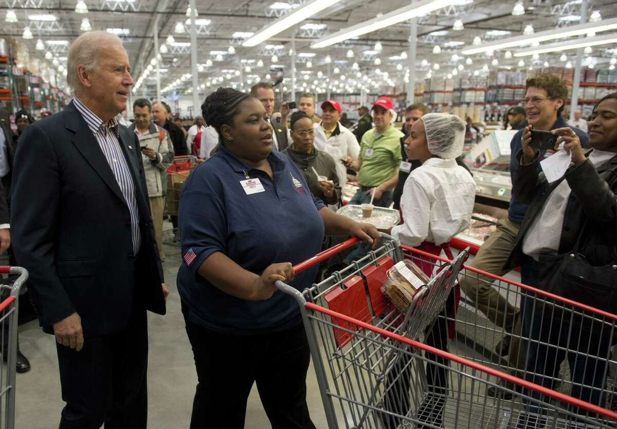 Apparently, when you are the vice president, someone else will push your cart. But employee Ivey Stewart did get a vice presidential hug at the end of shopping. ( SAUL LOEB/AFP/Getty Images)