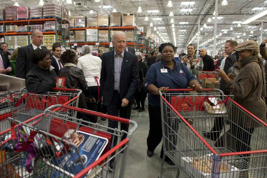 Just another day of buying big stuff with the big guy at Costco.  (SAUL LOEB/AFP/Getty Images) Photo: Ap/getty