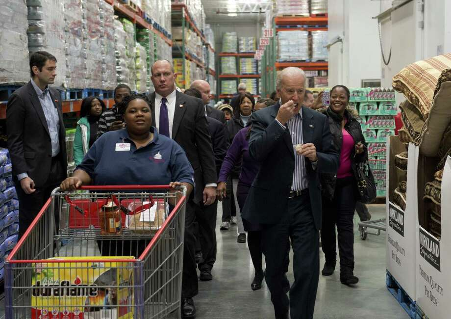 Biden ate a food sample. But who among us hasn't done the Costco nibble? But he hasn't learned to eat and push a cart at the same time. The Secret Service agent in the middle later wrestled a big jar of mayo to the ground. ( SAUL LOEB/AFP/Getty Images) Photo: Ap/getty