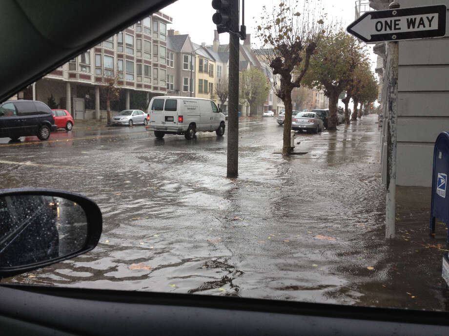 Flooding at the corner of Laguna and Sacramento streets after heavy rain Wednesday. (Nick Josefowitz / Courtesy)
