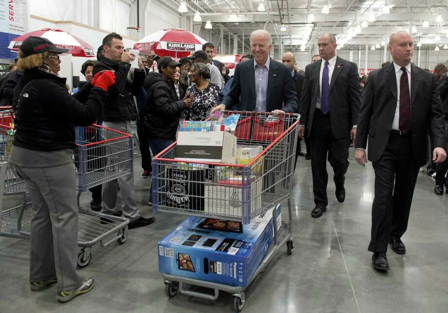 "Just in time for the college bowl season, Biden has a big-screen TV on the bottom of the cart. He declined the offers of the tire department to stop by. ""Hey man, I don't need tires,"" pool reports quote him as saying. ""I don't drive anymore.""(Photo credit should read SAUL LOEB/AFP/Getty Images) Photo: Ap/getty"