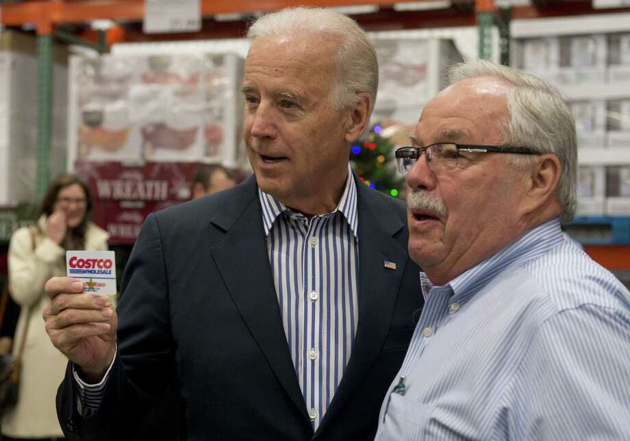 "When the vice president shows up, so does the big brass all the way from Costco's Seattle-area headquaters. Biden holds up his Costco card alongside Costco co-founder Jim Sinegal. Sinegal said of Biden's visit, according to pool reports, ""As you can see he draws quite a bit of attention."" Biden himself admitted to reporter: ""In all honesty, I didn't have my own card, Jill (his wife) wouldn't let me have one,"" he said. ""I went to get my wife's card, and she said, 'No, No, get your own card.'"" The White House says the Bidens had been members in the past and paid $55 again this week to join.(SAUL LOEB/AFP/Getty Images) Photo: Ap/getty"