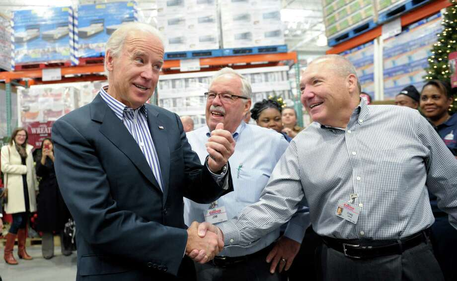 Vice President Joe Biden shakes hands with Costco CEO Craig Jelinek, right, as co-founder Jim Sinegal. Singel spoke at the Democratic convention last summer.   (AP Photo/Susan Walsh) Photo: Ap/getty