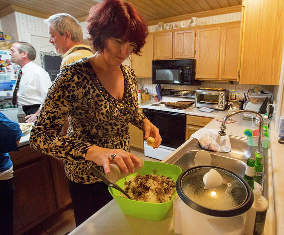 Host Lyne Jackson prepares rice during an international supper club at the home of Joe and Lyne Jackson  on Saturday, Nov. 24, 2012. MICHAEL MILLER / FOR THE EXPRESS-NEWS