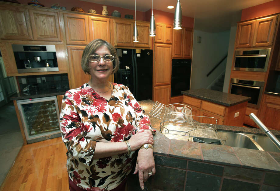 Jean Stein in her renovated kitchen. She and her husband Michael when through boxes of tiles to find the ones for her sink.  Wednesday, Nov. 7, 2012. Photo: Bob Owen, San Antonio Express-News / © 2012 San Antonio Express-News