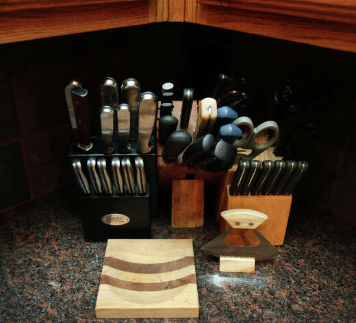 A collection of cutlery on the kitchen counter in Jean Stein's renovated kitchen.  Wednesday, Nov. 7, 2012. Photo: Bob Owen, San Antonio Express-News / © 2012 San Antonio Express-News