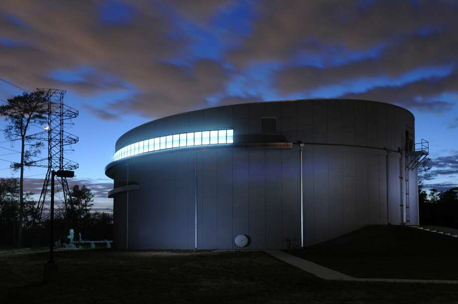 An evening shot of the Springwoods Village water plant, powered by solar energy panels, that will be used to treat the community's water. (CDC Houston)