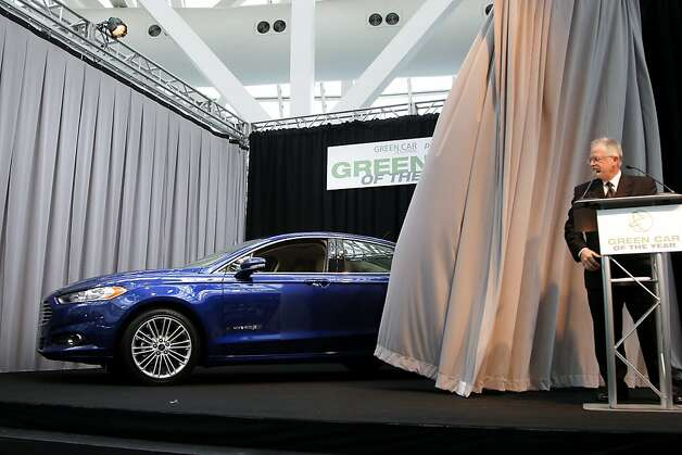 Ron Cogan, right, editor and publisher of the Green Car Journal, looks at  the Ford Fusion, the 2013 Green Car of the Year, at the LA Auto Show in Los Angeles, Thursday, Nov. 29, 2012. Photo: Jae C. Hong, Associated Press