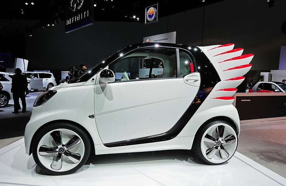 "The winged ""Smart forjeremy"" special edition Smart Car from Daimler AG is unveiled at the Los Angeles Auto show  in Los Angeles on media preview day, November 28, 2012.  Smart forjeremy is the creation of fashion designer Jeremy Scott, who conceived of the special edition car with fiberglass wings which double as tail lights.  The LA Auto Show opens to the public on November 30 and runs through December 9. Photo: Robyn Beck, AFP/Getty Images"