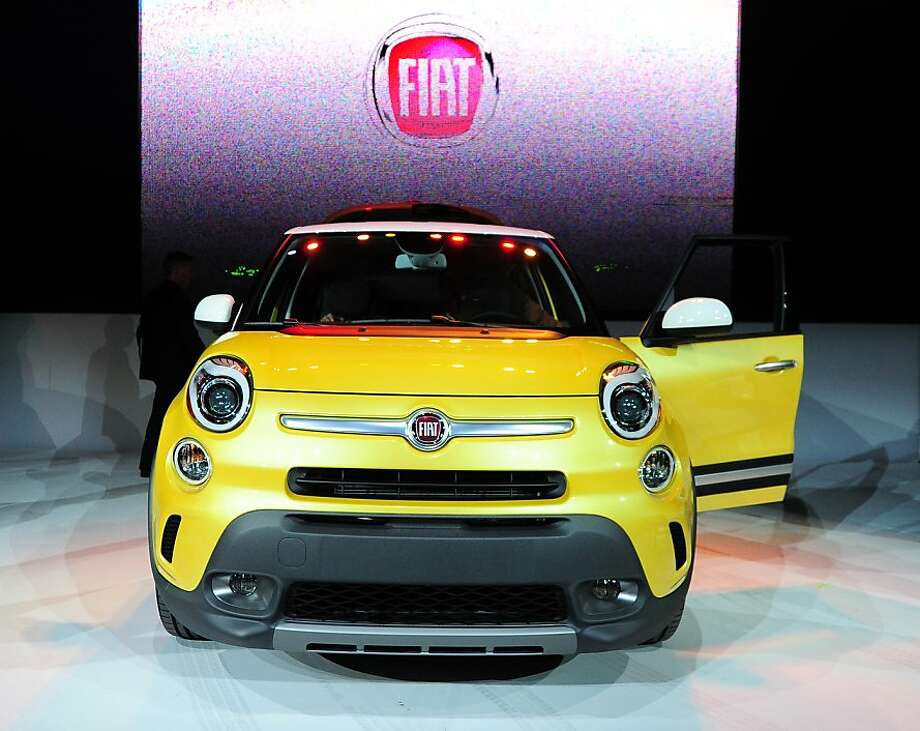 The Fiat 500L Trekking is displayed at its world premiere at the Los Angeles Auto show  in Los Angeles, California on media preview day, November 28, 2012. The 500L is a five-door sub-compact minivan with seating for five and looks that borrow styling cues from the smaller 500 city car.  The LA Auto Show will open to the public on November 30 and runs through December 9. Photo: Robyn Beck, AFP/Getty Images