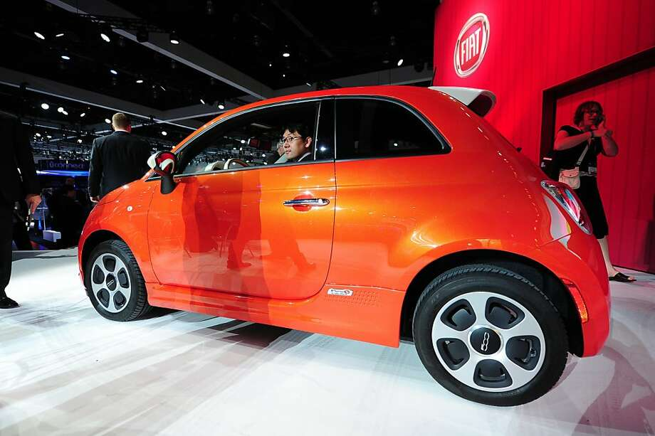 A visitor sits behind the wheel of the new  Fiat 500e electric car after it was unveiled at the Los Angeles Auto show  in Los Angeles, California on media preview day, November 28, 2012.  The LA Auto Show will open to the public on November 30 and runs through December 9. Photo: Robyn Beck, AFP/Getty Images