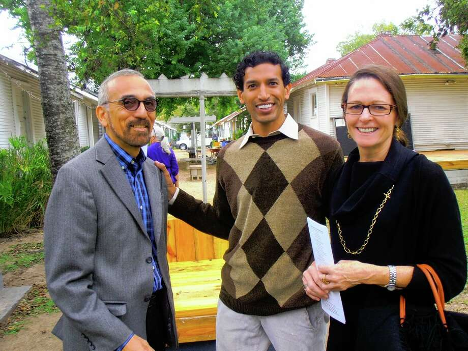 Richard Arredondo, from left, Suhail Arastu and Janet Brown explore the garden and playhouses of Project Row Houses during the SAMA Contemporaries art tour to Houston. Photo: Nancy Cook-Monroe/special To The