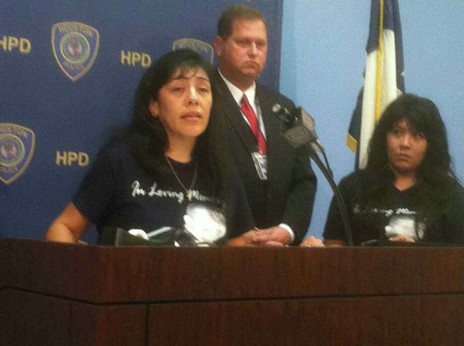 Norma Martinez, left, and her daughter, Veronica Martinez, along with Houston Police Department homicide officer M.J. Miller at a HPD news conference Thursday morning about the shooting death of John Martinez during a robbery outside the family home in the 7000 block of Ashburn about 10 p.m.Oct. 13. (Dale Lezon/HC) Photo: Dale Lezon
