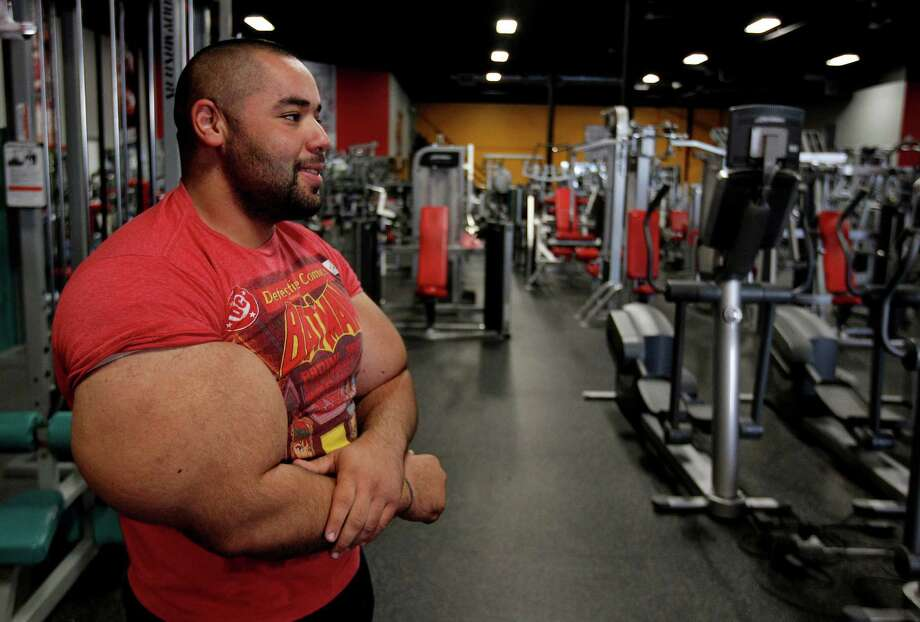 In this photo taken, Friday, Nov. 16, 2012, Egyptian Body builder Moustafa Ismail pauses before beginning another routine during his daily workout at World Gym in Milford, Mass. Ismail has been given the title of world's biggest arms, biceps and triceps, by the Guinness Book of World Records. Photo: Stephan Savoia, AP / AP
